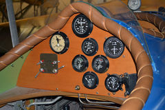 Retro biplane controls closeup. A closeup of vintage retro biplane sports an array of instruments and switches Royalty Free Stock Photos