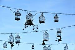 Retro birdcages, decoration. Decoration with different vintage birdcages against blue sky Stock Photos
