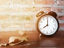 Retro black alarm clock with eight o`clock Stock Photography
