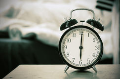 Retro black alarm clock show 6 o'clock in the morning for wake u Stock Photography