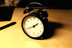 Retro black alarm clock Stock Image