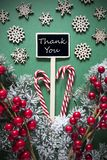 Retro Black Christmas Sign,Lights, Text Thank You. Vertical Black Sign With English Text Thank You. Christmas Decoration, Like Fir Tree Branch, Candy Sticks stock photos