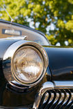 Retro Black Classic Car. Closeup headlight and grille of an old black classic car stock images