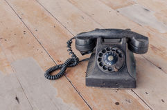 Retro black old telephone, retro style. Retro black old telephone on wooden background, retro style Royalty Free Stock Photography