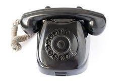 Retro black phone. Isolated on white background Stock Image