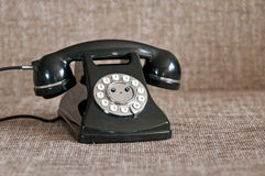 Retro black telephone. On retro background Royalty Free Stock Photo