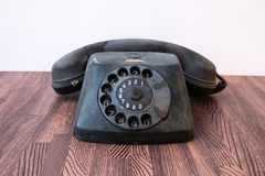 Retro black telephone on table in front mint green background wa Stock Photography