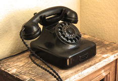 Retro black telephone. On wooden table Royalty Free Stock Photo