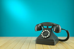Retro black telephone on wooden table. Concept 3d Royalty Free Stock Images
