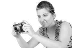 Retro monochrome pretty woman photographer Royalty Free Stock Photography