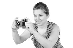 Retro monochrome pretty woman photographer Stock Images