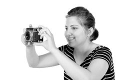 Retro monochrome pretty woman photographer Stock Photo