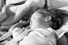 Sleeping little girl. Carefree sleep little baby with a soft toy Stock Image