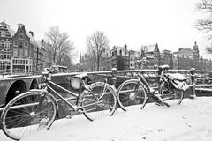 Retro black and white picture from snowy bicycles in Amsterdam Netherlands Royalty Free Stock Photography