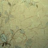 Retro blom- tapet i guld- design Arkivbilder