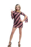 Retro Blond Peace Sign. Beautiful young blond in a pink and brown retro dress giving the peace sign Royalty Free Stock Photos