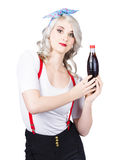 Retro blond woman with a bottle of soda Stock Photography