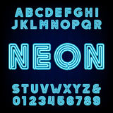 Retro blue neon tube alphabet. Type letters and numbers. Retro blue neon tube alphabet. Type letters and numbers on a dark background. Vector font for labels vector illustration
