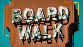 Retro Boardwalk Sign. A Retro Vintage Rustic Neon Boardwalk Sign In California Royalty Free Stock Images