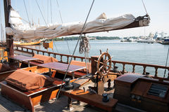 Retro boat on the Gulf of Finland. Wooden deck retro yachts with folded sails on the Gulf royalty free stock image