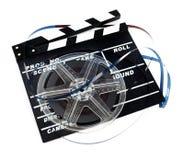 Retro bobina di film con ciak Immagini Stock Libere da Diritti