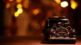 Retro bokeh dell'oro dell'automobile del giocattolo archivi video