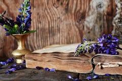 Retro book on wooden table key Royalty Free Stock Photos
