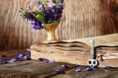 Retro book on wooden table key