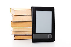 Retro books and modern ebook Stock Image