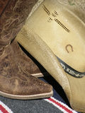 Retro Boots. Distressed leather western boots with cowboy hat Stock Photos