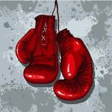 Retro boxninghandskar i rött Arkivbilder