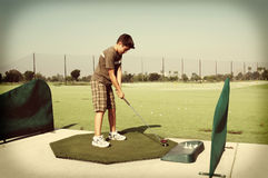 Retro Boy at Driving Range Stock Images