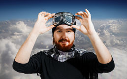 Retro Boy Pilot. Man wears glasses, fantasy image of Aviator against the sky. Retro Boy Pilot. The man in glasses and scarf, fantasy image of Aviator and Royalty Free Stock Photo