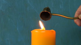 Retro Brass Sniffer Bell for extinguishing candle flame stock video footage