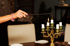 Extinguishing candles Stock Images
