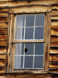 Really Retro. Broken window in abandoned stagecoach station in Colorado royalty free stock photo