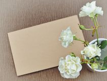 Retro brown background. With flowers and copy space. Blank page for design with sack texture. Gift card. Empty vintage postcard on sacking cloth Royalty Free Stock Image