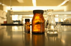 Retro brown bottle with flask in science laboratory. Background Royalty Free Stock Photos
