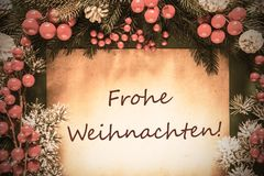 Retro Christmas Decoration, Frohe Weihnachten Means Merry Christmas royalty free stock photography