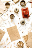 Retro brown style workspace with vintage photo camera, craft envelope, pencils, tools and twine on white background. Flay lay composition for bloggers, artists Royalty Free Stock Photography