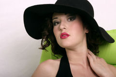 Retro brunette. Pretty model in old fashion hat Royalty Free Stock Image