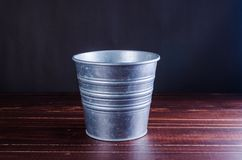 Retro bucket on wooden board background Royalty Free Stock Photo