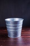 Retro bucket on wooden board background Royalty Free Stock Image