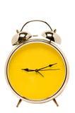 Retro budzik Z Żółtą twarzą Odizolowywającą Obraz Royalty Free