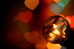 Retro bulb lamp lights with bokeh hearts Royalty Free Stock Photos