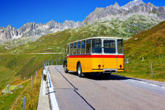 Retro bus. Alps road with retro bus Royalty Free Stock Photo