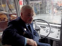 Retro bus driver behind the wheel stock image