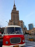 Retro bus and the Palace of Culture and Science. Warsaw, Poland - December 15, 2017: Retro bus and the Palace of Culture and Science, a notable high-rise Stock Photography
