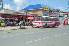 Retro bus at Russia. Red retro bus at Russia, city Maikop. Urban street view. Peoples and buildings. 2014 Royalty Free Stock Photo