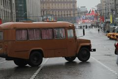 Retro the bus on streets of Moscow in day of procession of communists Royalty Free Stock Photo